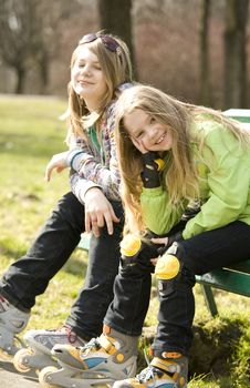 Free Two Happy Grils Sitting On Bench Stock Photo - 8757310