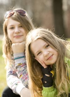 Free Two Happy Grils Sitting On Bench Stock Images - 8757834