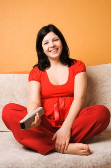 Free Beautiful Pregnant Woman Sitting On The Couch Royalty Free Stock Photography - 8759247