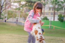 Free Portrait Of A Smiling Young Woman With Dog Royalty Free Stock Image - 87503986