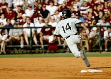 Free Baseball Player Number 14 Chasing Goal On Baseball Field Stock Photos - 87588633