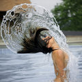 Free Woman And Arcs Of Water In Pool Royalty Free Stock Photos - 8762628