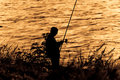 Free Fisherman Silhouette On Sunset. Stock Photography - 8765972