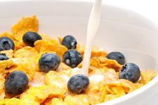 Free Pouring White Milk Into A Bowl Of Breakfast Flakes Stock Photo - 8761090