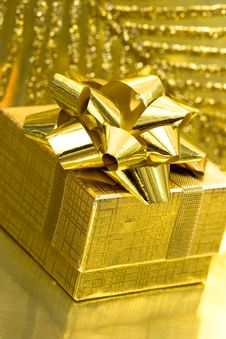 Free Gift Box On Golden Background Royalty Free Stock Photos - 8761768