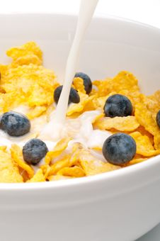 Free Pouring White Milk Into A Bowl Of Breakfast Flakes Stock Image - 8761961