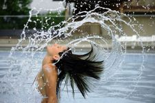 Free Woman And Arcs Of Water In Pool Stock Photos - 8762603