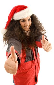 Free Female Wearing Christmas Hat And Showing Thumbs Up Royalty Free Stock Images - 8766179