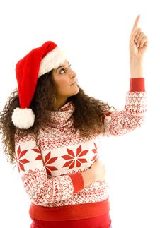 Free Woman Wearing Red Christmas Hat And Pointing Stock Photo - 8766330