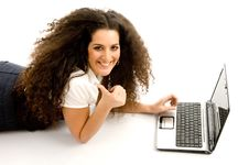 Free Woman Showing Thumbs Up And Working On Laptop Stock Images - 8767234