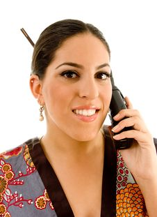 Free Pretty Young Woman In Kimono Busy Talking On Phone Royalty Free Stock Photo - 8767775