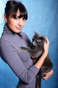 Free Beautiful Woman Holding Cat Stock Photography - 8768192