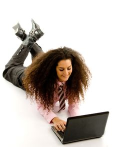 Free Young Female Lying On Floor Working On Laptop Stock Image - 8768351