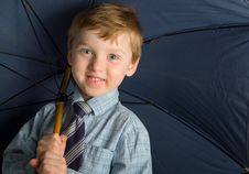Free Boy With Blue Umbrella Stock Images - 8768634