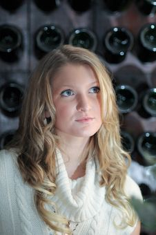 Free Blond Girl In Front Of Wine Rack Stock Image - 8769091
