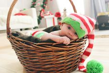 Free Baby Playing In Wicker Basket Stock Photos - 87660853