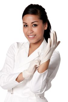 Free Beautifull Indonesian Nurse Putting Gloves On Stock Photography - 8771192