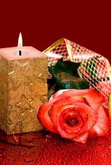 Golden Candle With Rose Stock Photography