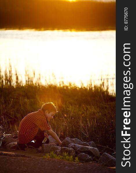 Little boy exploring at sunset