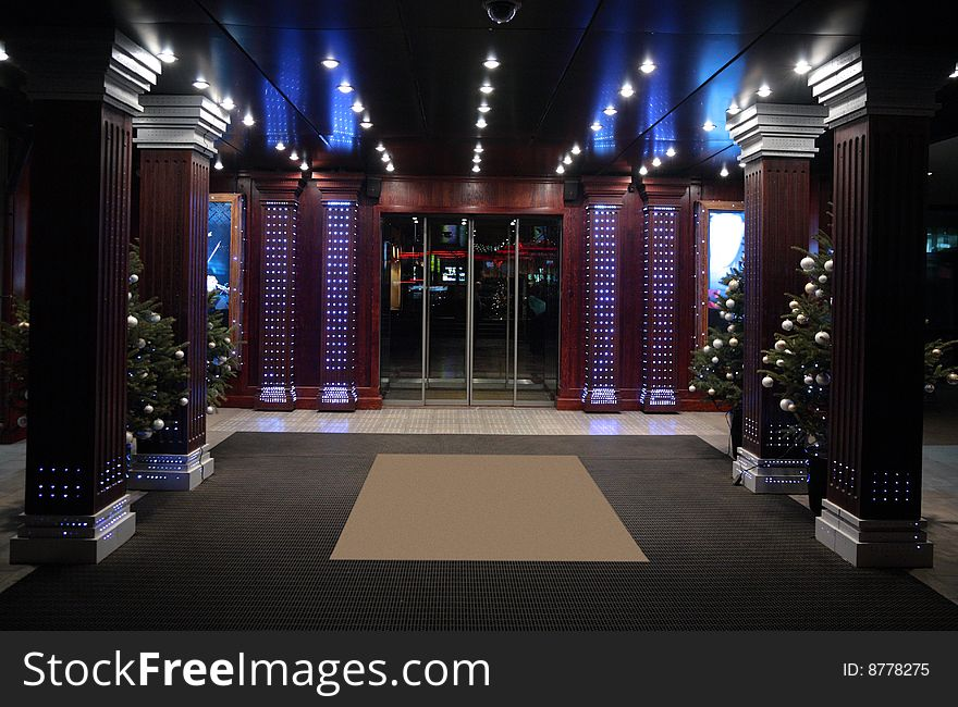Enter in  building with New Year trees