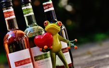 Free Green Frog With Red Heart Figurine Beside Glass Bottles Stock Images - 87780964