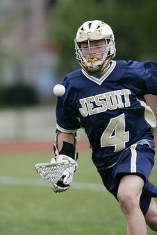 Free Man Holding Lacrosse Stick Running On Field During Daytime Royalty Free Stock Image - 87780976