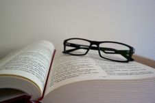 Free Close-up Of Eyeglasses On Book Royalty Free Stock Photo - 87781665