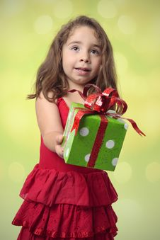 Free Pretty Girl Giving Present Stock Image - 8782461