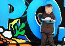 Free Boy Against Graffiti Wall. Royalty Free Stock Images - 8784459