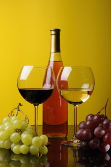 Two Glasses And A Bottle Of Wine Royalty Free Stock Photos