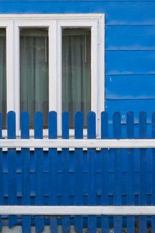 Free Country Home Painted In Blue, With White Window Frames And Matching Fence. Royalty Free Stock Photos - 87852228