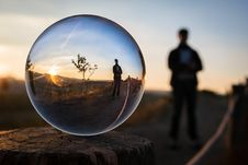Free Person Reflected In Ball At Sunset Stock Photo - 87856160