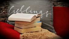 Free Books Pile On A Chair And Shaggy Rug Royalty Free Stock Photos - 87856258