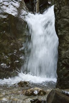 Free Forest Waterfall Blurred In Slow Motion Capture. Royalty Free Stock Photography - 87856397