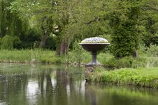 Free Ornamental Flower Pot By Lake Royalty Free Stock Photo - 87856515