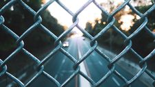 Free Streets Seen Through Fence Royalty Free Stock Image - 87856786