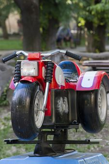 Free Photo Of A Motorcycle Toy In A Children S Play Area. Stock Image - 87856841