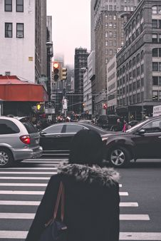 Free Woman Waiting To Cross A Busy Road Stock Images - 87857074