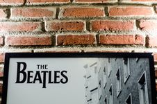 Free Brick Wall With Beatles Poster Royalty Free Stock Photography - 87858897