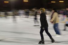 Free Woman-gliding-on-ice-at-skating-rink Royalty Free Stock Photos - 87859548