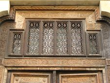 Free Wrought-iron-ornamentation-above-carved-wooden-door Royalty Free Stock Image - 87859696