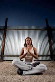 Free African-American Woman Meditating Royalty Free Stock Photography - 8792077