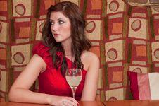 Woman Waiting At The Bar Royalty Free Stock Images
