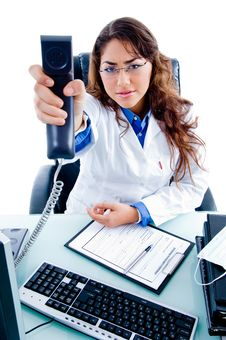Free Young Female Doctor Showing Phone Receiver Stock Photos - 8795903