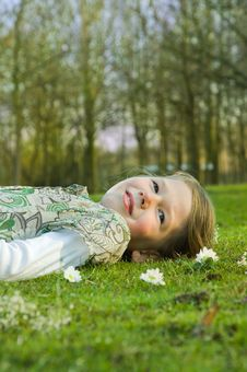 Free Girl Relaxing On Grass In Park. Stock Photography - 8797482