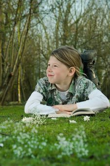 Free Girl Reading Book On Grass Royalty Free Stock Photography - 8797507