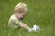 Free Little Boy In The Grass Stock Images - 885494