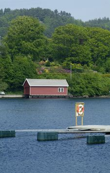 Free Boathouse And Lifesaving Ring Stock Photography - 886922