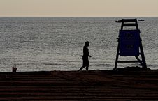 Lonely Man And Lifeguard Tower Stock Images