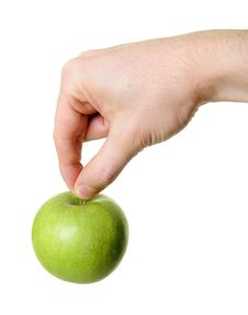 Green Apple Hanging From Hand Stock Photography